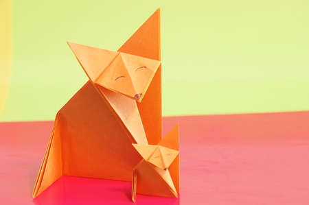 Paper Origami Fox Isolated On A Colorful Background Stock Photo