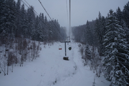 water skiers: The chairlift ski lifts up the mountains in winter
