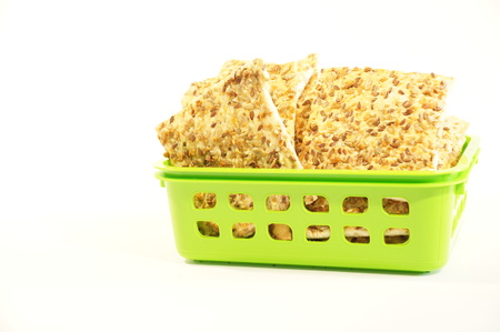 sesame cracker: Dietary cookies with sesame seeds, flax and sunflower isolated on white background