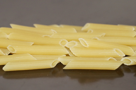 carbohydrates: Pasta, pasta, isolated on a black background. Raw pasta. Flour food. Italian Cuisine.