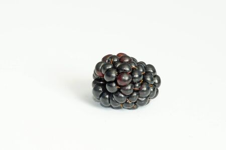 Ripe and juicy blackberries isolated on white background.