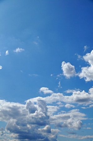 Fluffy white clouds on blue