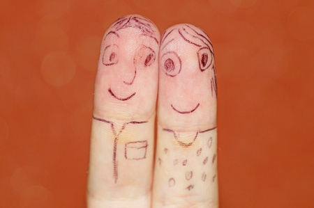memes: A pair of fingers. Fingers of the hand in the form of a loving couple of people. Stock Photo