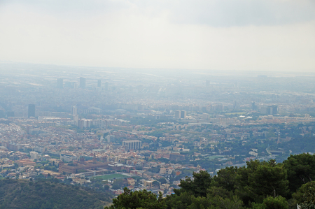 Tibidabo. Beautiful view of Barcelona from the mountain of Tibidabo. The city is surrounded by forest and nature.