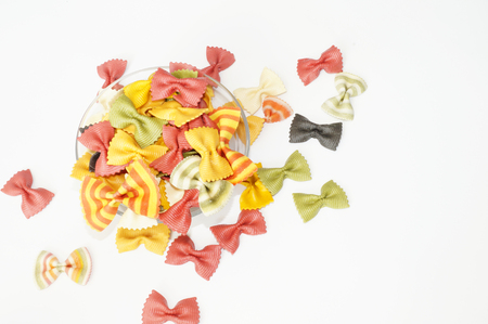 Funny multicolored pasta. Beautiful pasta in the form of a butterfly. Stock Photo