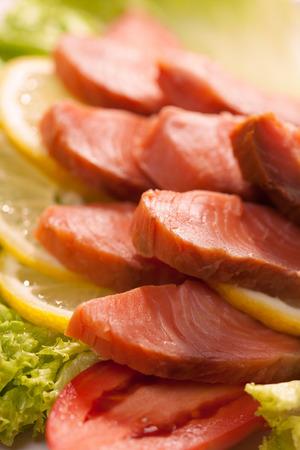 kipper: Kipper slices with lemon and lettuce