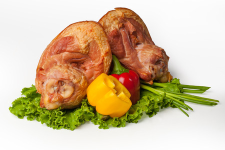 The composition of pork knuckle isolated on a white background