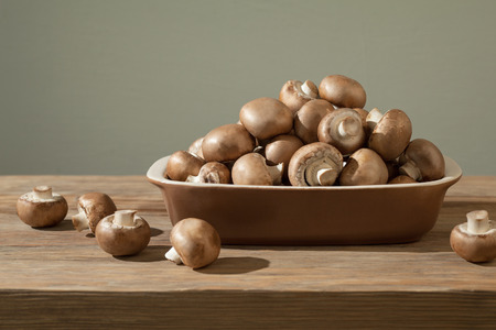 Mushrooms composition on wood table photo