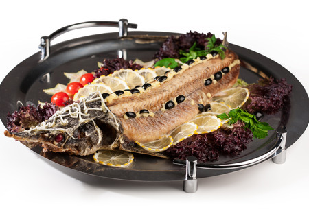 sturgeon: christmas table meal seafood delicious sturgeon served with vegetables Stock Photo