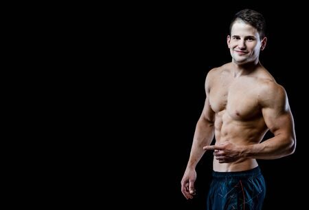 six packs: Studio shot on black background. Showing six packs of abs. Stock Photo
