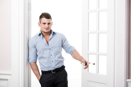 Portrait of a well built muscular male model against light background Stock Photo