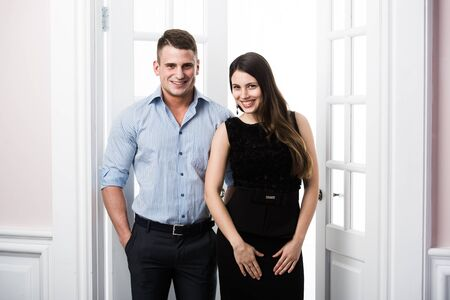 well built: Well built muscular man in a shirt and beautiful girl in bussiness dress Stock Photo