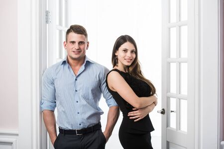 bussiness man: Well built muscular man in a shirt and beautiful girl in bussiness dress Stock Photo