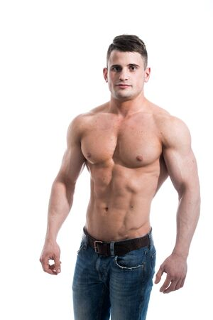Torso of strong guy in jeans against white background