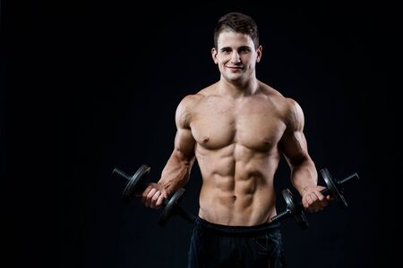 six pack: Man showing his six pack abs on dark background Stock Photo