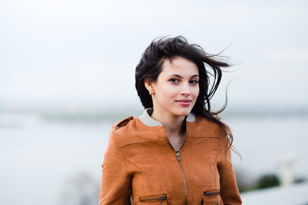 leather coat: Beautiful outdoors portrait of a woman in leather coat