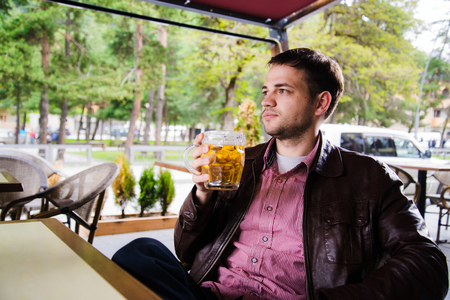 sitted: Sitted and relaxed man with a beer in peace.