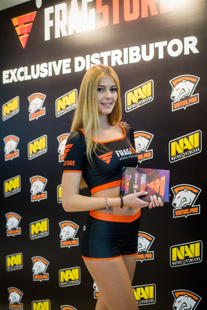 epicenter: MOSCOW, RUSSIA - MAY 13 2016: EPICENTER MOSCOW Dota 2 cybersport event. Beautiful promo girl over virtus pro and natus vincere banner