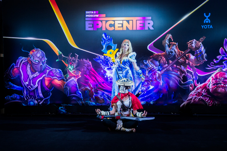 dire: MOSCOW, RUSSIA - MAY 13 2016: EPICENTER MOSCOW Dota 2 cybersport event. Cosplay of game heroes crystal maiden and juggernaut at the event background
