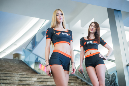 epicenter: MOSCOW, RUSSIA - MAY 13 2016: EPICENTER MOSCOW Dota 2 cybersport event. Beautiful promo girls over ladder on the background