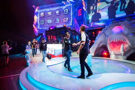 epicenter: MOSCOW, RUSSIA - MAY 14 2016: EPICENTER MOSCOW Dota 2 cybersport event. Team Complexity and team virtus pro captains shaking hands. Editorial