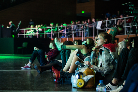 epicenter: EPICENTER MOSCOW RUSSIA Dota 2 cybersport event may 13. Tournament spectators relaxing on the poufs and watching the game Editorial