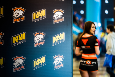 dire: MOSCOW, RUSSIA - MAY 13 2016: EPICENTER MOSCOW Dota 2 cybersport event. Beautiful promo girls over virtus pro and natus vincere banner Editorial