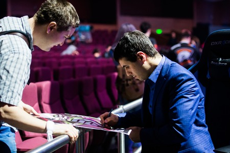 commentator: MOSCOW, RUSSIA - MAY 14 2016: EPICENTER MOSCOW Dota 2 cybersport event. Caster Commentator Versuta of the game giving the autograph Editorial