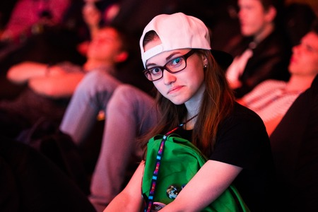 dire: MOSCOW, RUSSIA - MAY 14 2016: EPICENTER MOSCOW Dota 2 cybersport event. Tournaments beautiful spectator girl fan.