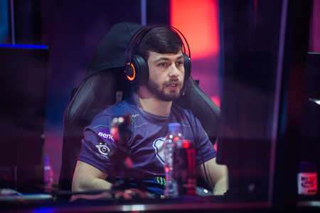 epicenter: MOSCOW, RUSSIA - MAY 14 2016: EPICENTER MOSCOW Dota 2 cybersport event. Evil geniuses captain clinton Fear Loomis in the cabin on the stage tired.