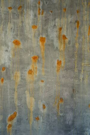 green brown: old green brown surface and concrete wall with rusted spots. Stock Photo