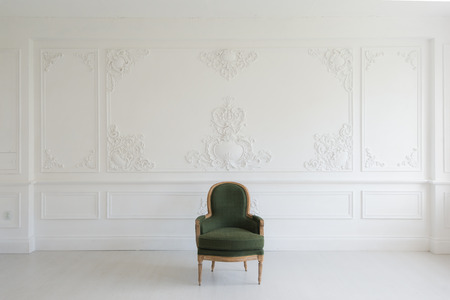 antique wood: Antique green armchair fretwork wall on backround Stock Photo