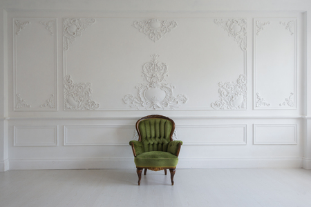 chair wooden: Antique green armchair fretwork wall on backround Stock Photo