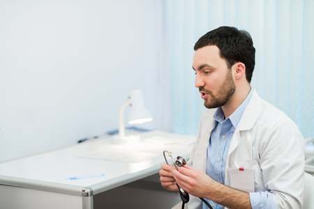 color consultation: Doctor in consultation with patient sitting in front of him.