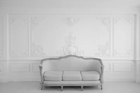 white sofa: Antique white sofa fretwork wall on backround