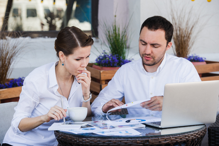 stumped: Male and female business colleagues working together on a hard problem. They have a strained expression on their faces Stock Photo