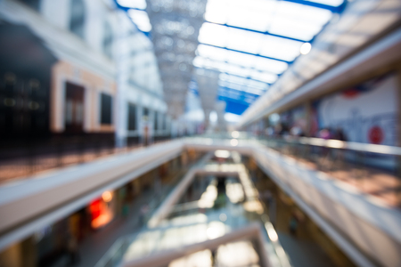 multilevel: Blured big mall multi-level shopping center with bokeh background.
