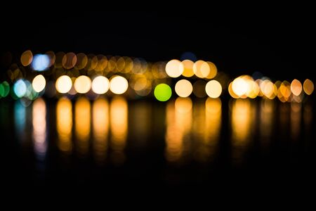 City and river at night - blur photo,Bokeh background.