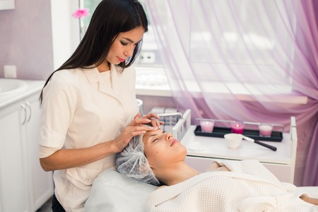 cosmetologist: Woman cosmetologist to work in beauty salon. Stock Photo