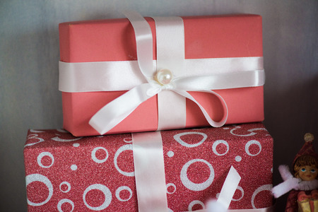 holyday: holyday gifts pink boxes with white bow macro close up.