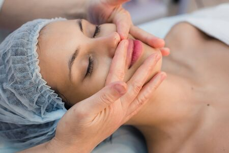 oriental massage: Young, beautiful and healthy woman in spa salon. Traditional oriental massage therapy, beauty treatments