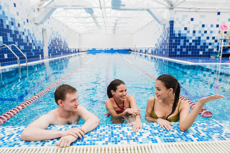 happy teen group at swimming pool class learning to swim and have fun. Stock Photo