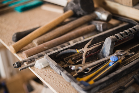 scraped: still life tool box with nails rasp and old tools.
