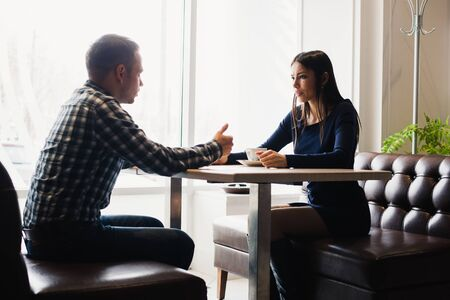argues: Scene in cafe - couple conflict arguing during the lunch Stock Photo