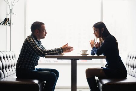 lovers quarrel: Scene in cafe - couple conflict arguing during the lunch Stock Photo