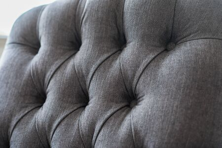 cushioned: Seamless background texture close up of a grey sofa back with button detail on a thick cloth.