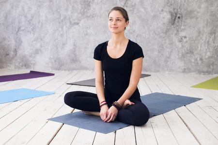 Woman practicing meditation at a yoga studio