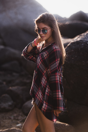chatty: Outdoor fashion image of stylish young lady,fashionable.Lifestyle portrait of stunning hipster girl, wearing elegant glamour shirt dress and vintage sunglasses