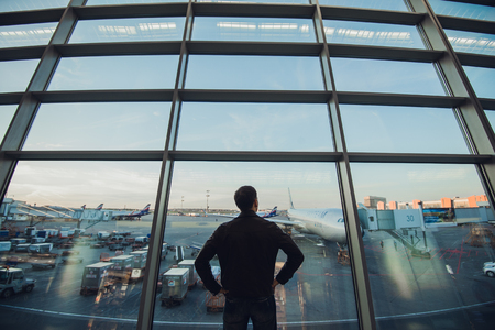 flight mode: Silhouette of man waiting for the flight