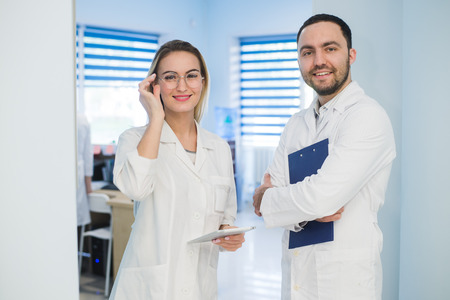Medical Staff Having Discussion In Modern Hospital Corridor Stock Photo